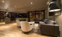 Aspect Niseko Living and Dining Area at Night | Middle Hirafu Village