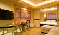 M Hotel Suite Living Area with Sofa and TV | Middle Hirafu