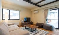 Tahoe Lodge Lounge Area with TV | East Hirafu