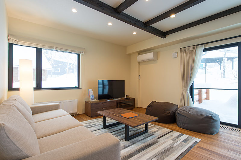 Tahoe Lodge Lounge Area with TV   East Hirafu