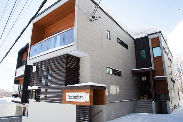 Toshokan Townhouses Outdoor Area with Entrance | Middle Hirafu