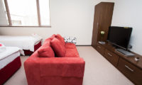 Toshokan Townhouses Twin Bedroom with Sofa and TV | Middle Hirafu