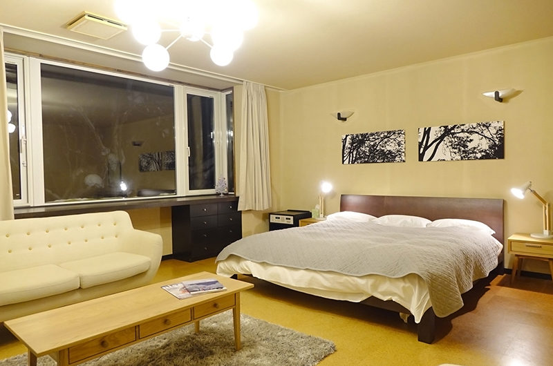Ebina Chalet and Lodge Bedroom with Seating Area | Moiwa