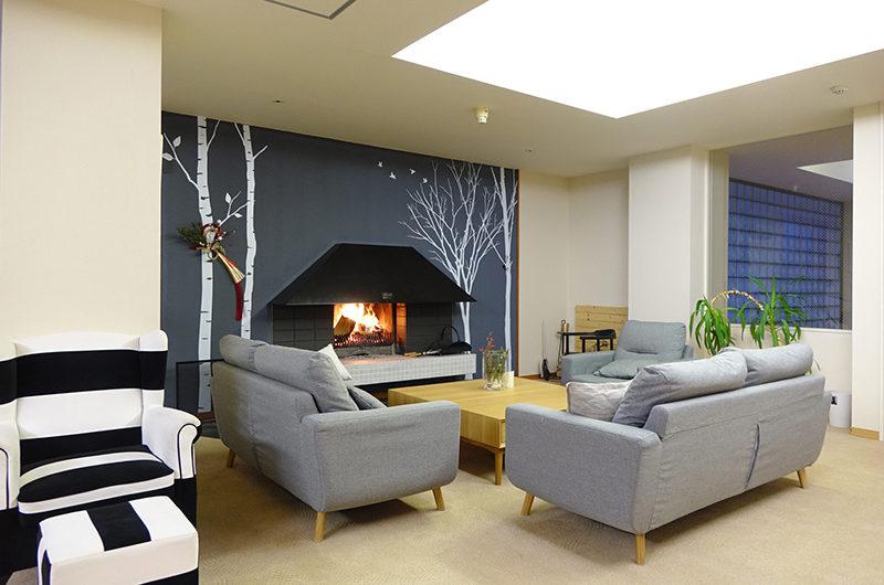 Ebina Chalet and Lodge Lounge Area near Fireplace | Moiwa