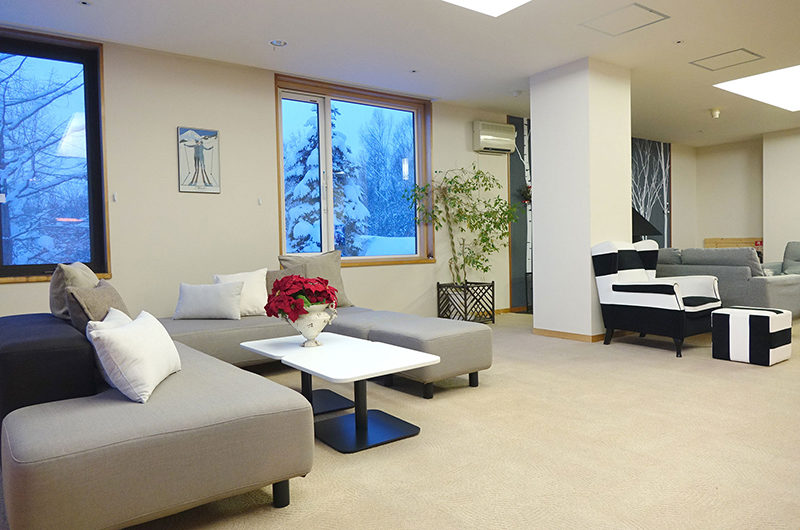 Ebina Chalet and Lodge Lounge Area with Carpet | Moiwa