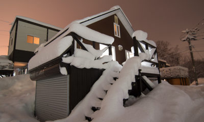 Kuma Cabin Outdoor View of Up Stairs with Snow | Lower Hirafu