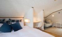 Kuma Cabin Bedroom with Wooden Floor and Sofa | Lower Hirafu