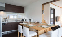 Kuma Cabin Kitchen and Dining Area with Wooden Floor | Lower Hirafu