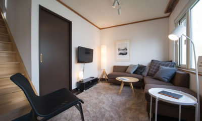 Kuma Cabin Lounge Area with TV | Lower Hirafu