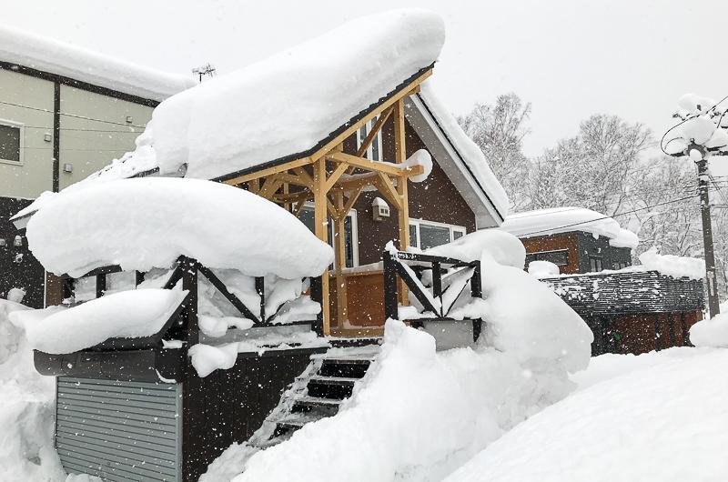 Kuma Cabin Exterior with Snow | Lower Hirafu