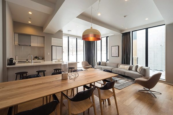 The Kamui Niseko Living Kitchen and Dining Area with Wooden Floor | Annupuri