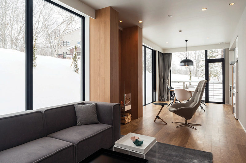 The Kamui Niseko Living and Dining Area with Wooden Floor | Annupuri