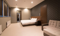 The Trees Chalets Bedroom with Carpet and Sofa | West Hirafu