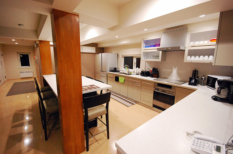 Cisco Moon Lodge Kitchen and Dining Area with Utensils | Lower Hirafu