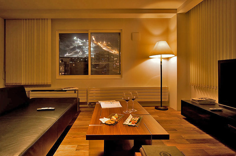 J-Sekka Suites Lounge Area with Night View | Middle Hirafu