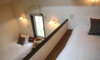Popcorn Lodge Bedroom with Triple Beds | East Hirafu