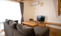 Bliss Cottage Sakura Living Area with TV | East Hirafu