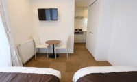 Bliss Lodging Twin Bedroom with TV | East Hirafu