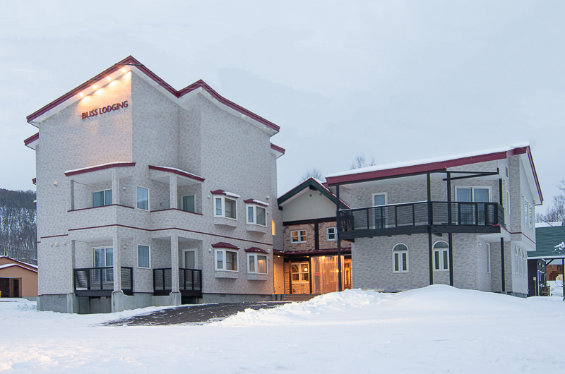 Bliss Lodging Exterior with Snow | East Hirafu