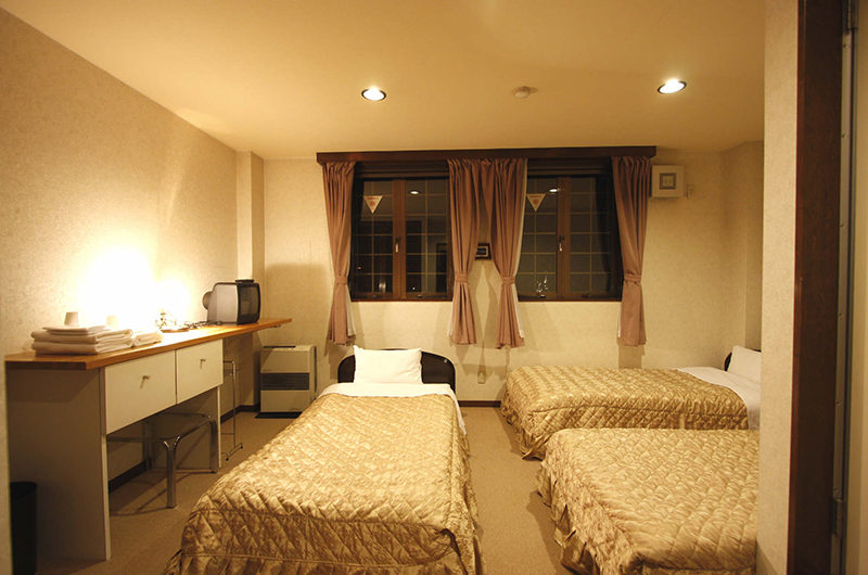 Aria Hotel Bedroom with Three Beds | Lower Wadano