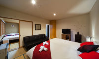 Luna Hotel Bedroom with Sofa and TV | Upper Wadano