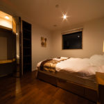 Phoenix Chalets Bedroom at Night with Lamp   Lower Wadano