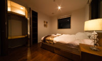 Phoenix Chalets Bedroom at Night with Lamp | Lower Wadano