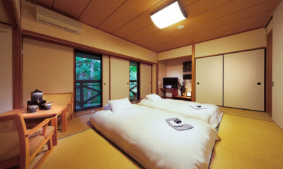 Phoenix Hotel Bedroom with Seating Area | Lower Wadano