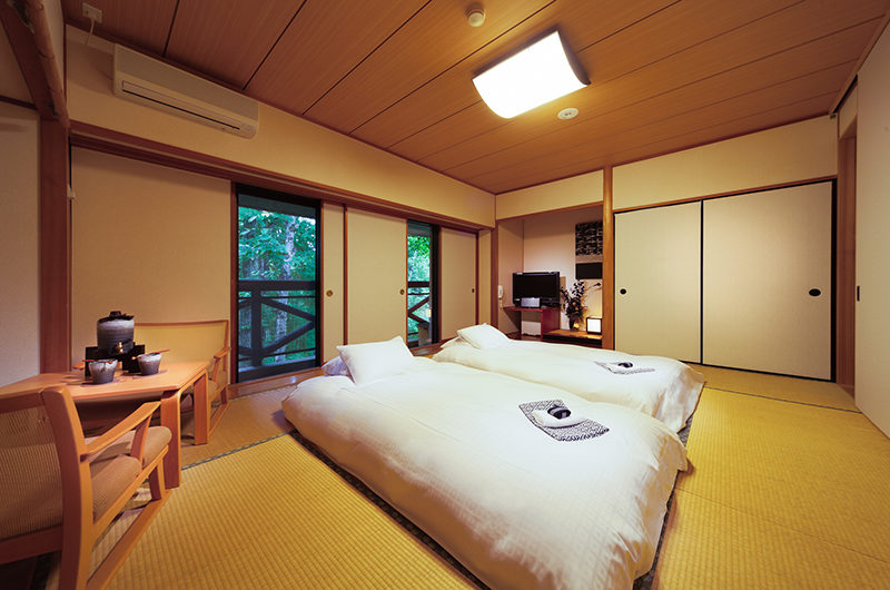 Phoenix Hotel Bedroom with Seating Area | Lower Wadano