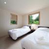 Solar Chalets Twin Bedroom | Upper Wadano