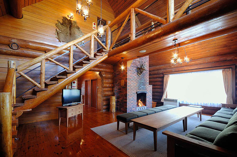 Rusutsu Log Houses Living Area near Fireplace | Rusutsu