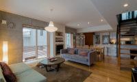 Kitanishi Two Indoor Living Area with Wooden Floor | Middle Hirafu