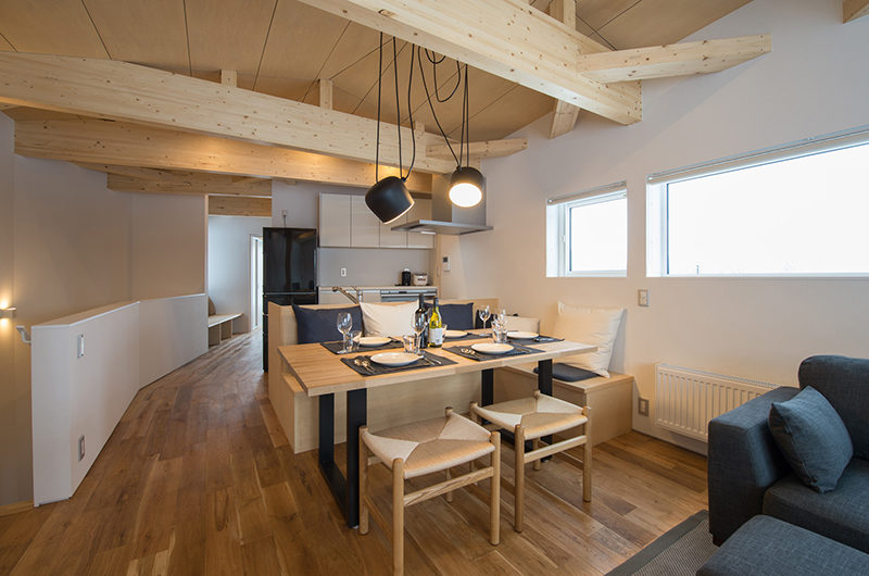 Yorokobi Lodge Dining Area with Wooden Floor | West Hirafu