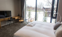 The Kamui Niseko Bedroom with TV and Outdoor View | Annupuri