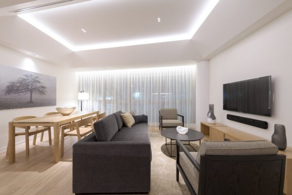 Skye Niseko Two Bedroom Suite Living Area with TV | Upper Hirafu Village