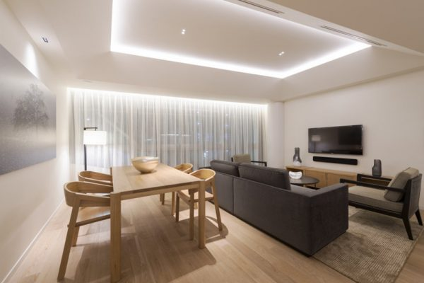 Skye Niseko Two Bedroom Suite Living and Dining Area | Upper Hirafu Village