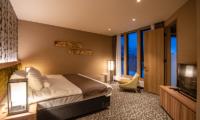 Panorama Niseko Bedroom with Carpet and TV | East Hirafu