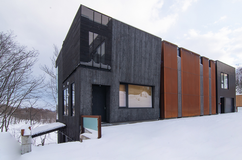 Hideaway on Escarpment Exterior with Snow | Lower Hirafu