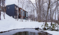 Hideaway on Escarpment Exterior with Pond | Lower Hirafu