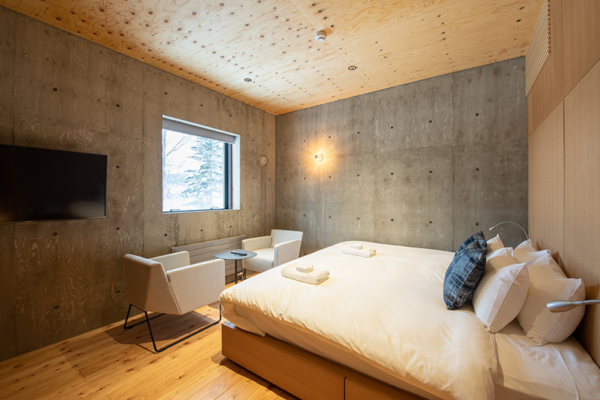 Puffin Bedroom with Seating Area and TV | Lower Hirafu