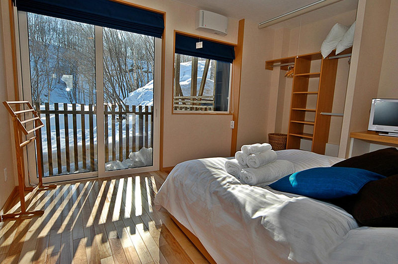 Casi 67 East Bedroom and Balcony with View | Lower Hirafu