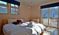 Casi 67 East Bedroom with Wooden Floor | Lower Hirafu