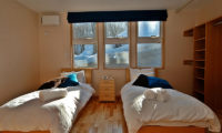 Casi 67 West Twin Bedroom with Outdoor Snow View | Lower Hirafu