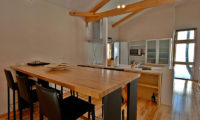 Casi 67 West Kitchen and Dining Area with Wooden Floor | Lower Hirafu