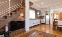 Snow Fox Kitchen and Dining Area with Up Stairs | Lower Hirafu