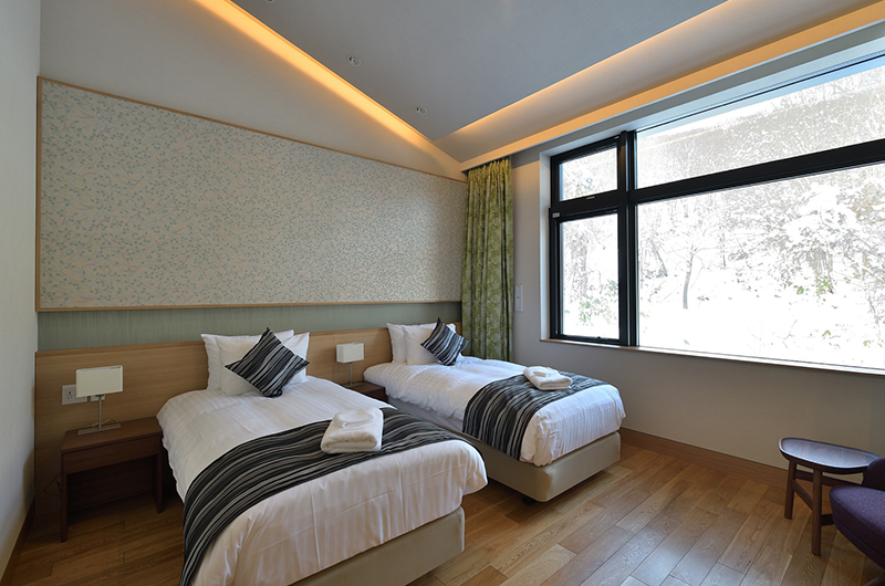 Tsudoi Twin Bedroom with Wooden Floor | East Hirafu